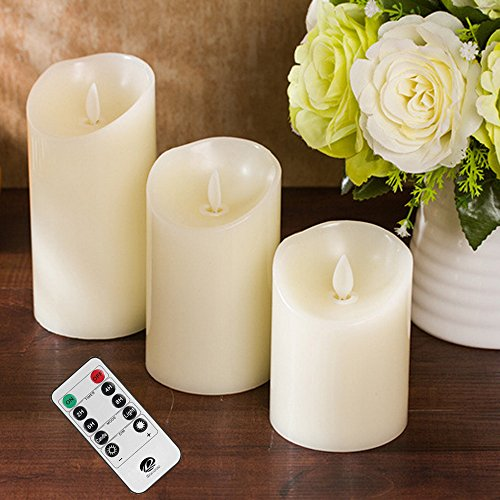 Haoran Ivory Real Wax Pillars Votive Candles Battery Operated LED Lighted Realistic Flickering Flameless Candles Set with 10-Key Remote Timer Set of 3 Amber Yellow Timer and Dimmer Options